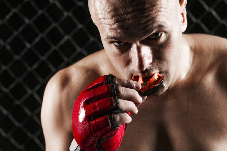 sportsman removing his mouth guard
